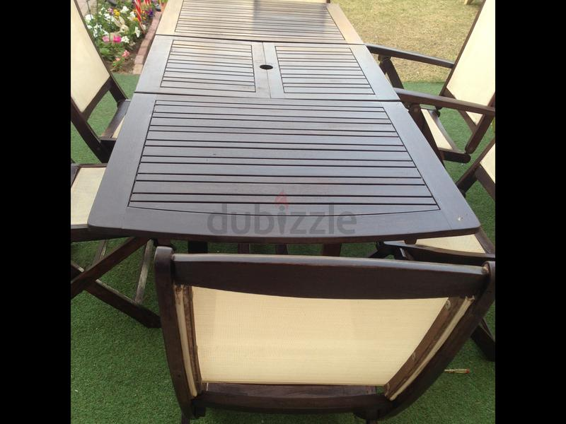 beautiful dark brown garden table with 6 chairs aed 1200