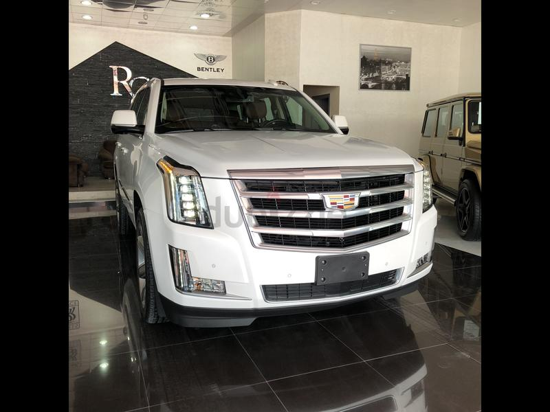 luxury detail serving escalade at used chevy cadillac banks