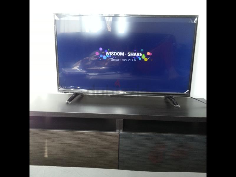 42 inch smart TV still under warranty with trolly