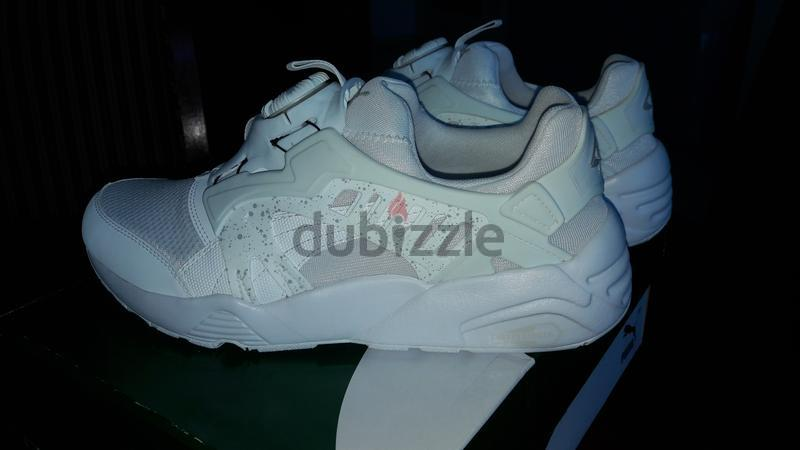 6eb307119f51e2 Puma Disc Blaze White Shoes For Sale - AED 160